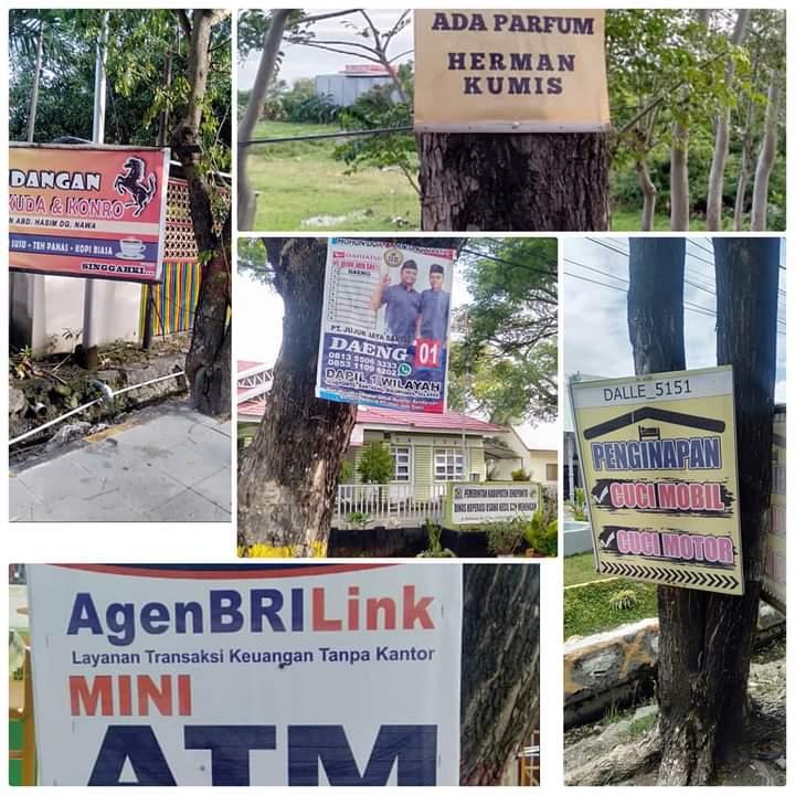 Pohon Kota Dipenuhi Banner Iklan Liar